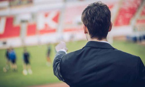 Manager man standing on stadium grandstand